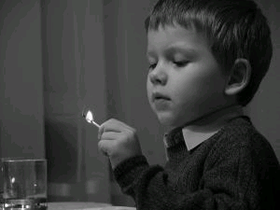 image of child holding a match