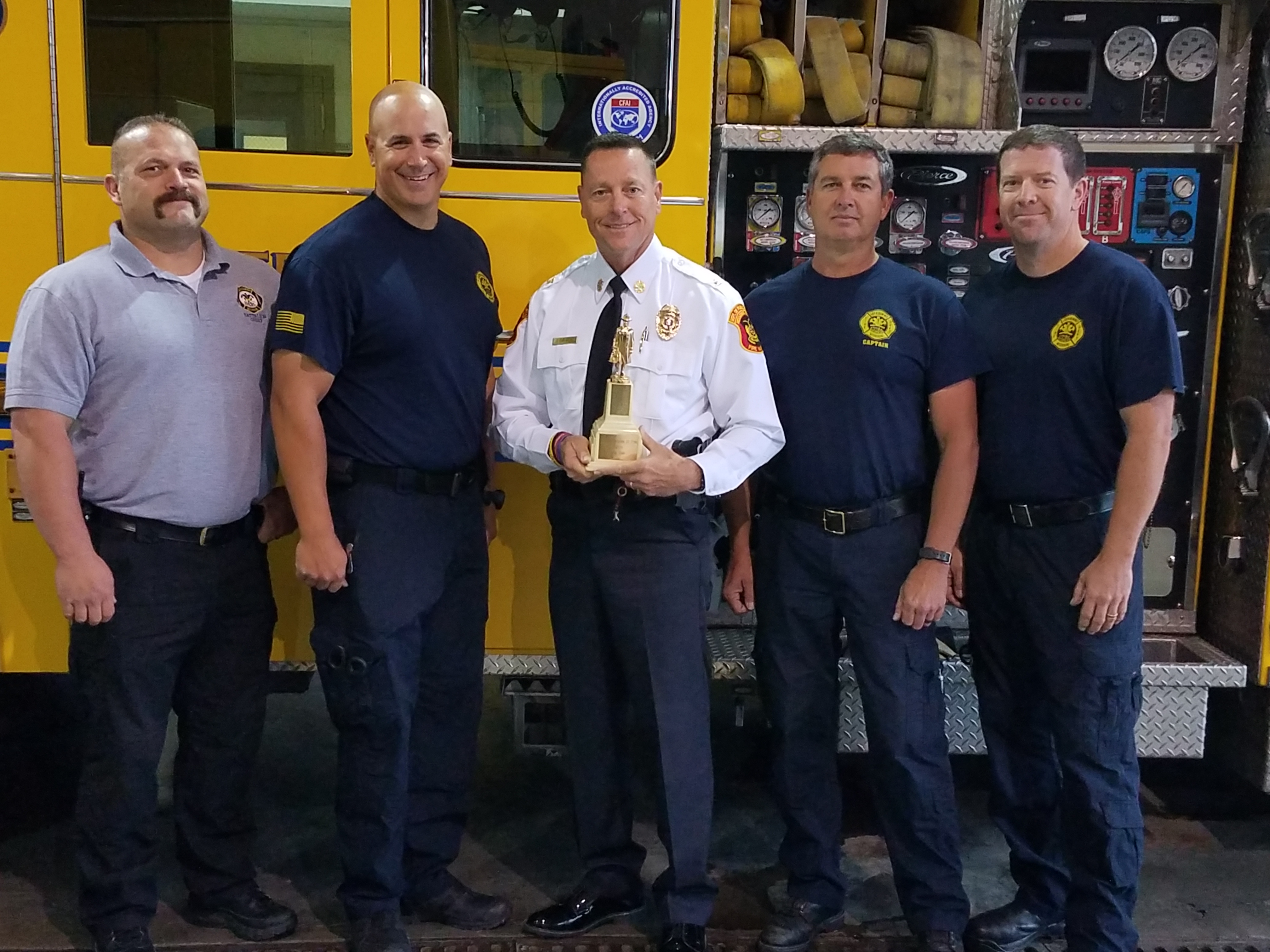 Salute to Service Captain Tom Loy, Paramedic Jacob Wiemann, Battalion Chief Arby Todd and Fire Specialist Craig Hill