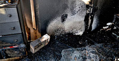 image of a burned room with space heater visible